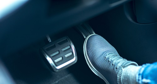 Man with foot on brake pedal